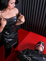 Mistress Lauren straps poor Theodore to her massive domination table and torments his body, working him over with cock and ball toture, and force feeding him her cock!