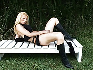 Hot blonde transsexual jerking off outdoors