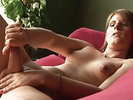 Irresistible transsexual jerking off on the sofa
