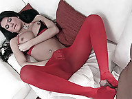 Sexy shemale in red pantyhose gets her cock sucked