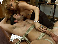 Johanna B. sucks, fucks & cums on a muscly jock who thought he could flirt his way into college.Her hard dick barely leaves his holes the entire shoot