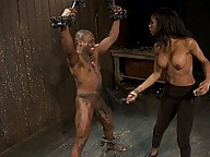 Ts Natassia Dream uses a guy bound in metal restraints, sucking his huge cock, fucking him, making him cum, she cums on his face in a suspended 69.