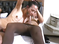 Black haired tranny sucks meaty shecock