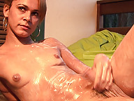 Horny shemale squirts her ass full of lotion