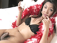 Brunette shemale from asia on black biniki jerking