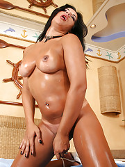 Shemale spreads creamy lotion on her fine tanned body