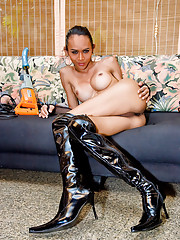 Leather clad dick-girl getting a fuck-drill ready