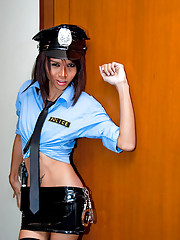 Police tranny in a skimpy outfit busts into a room