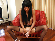 Black-stockinged t-girl giving her tool a good tug