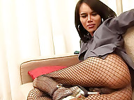 Freaky ladyboy works her rear thru ripped fishnets