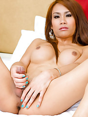 Exotic tranny Nan taking fun while using her hands