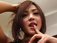 Ladyboy Aum beating her meat for creamy explosion