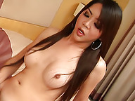 Curvy Asian ladyboy Lusi pleasuring her back hole