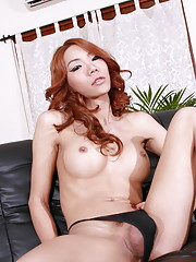 Naughty redhead Janny stripping and posing her long cock