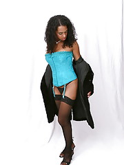 Beautiful transsexual Talise posing in a sexy corset & stockings