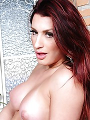 Naughty transsexual redhead stripping and posing