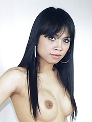 Exotical transsexual Candy posing her big cock and tits