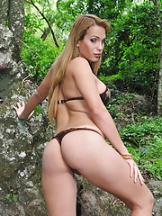 Adorable transsexual cutie Evelyn posing in the woods