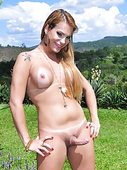 Stunning tgirl Evelin stripping and posing outdoors