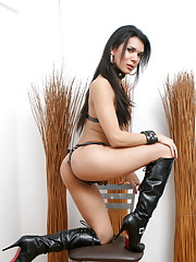 Adorable tgirl posing in black leather boots