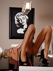 TS sweetheart Kimber James posing on the table