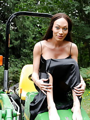 Transsexual sweetie Mia Isabella posing on a tractor