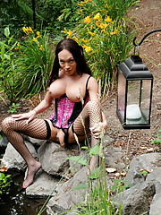 Cute Mia Isabella posing in sexy corset and stockings