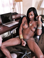 Ebony tgirl Natalia Coxxx giving a blowjob to her slave boy