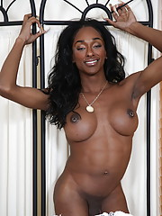 Beautiful ebony tgirl Natalia Coxxx stripping and teasing