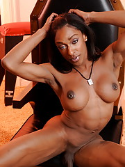 Lovely ebony transsexual Natalia Coxxx posing