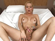 Transsexual babe Renata stroking off her huge juicy cock