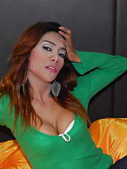 Lush ladyboy in green exposes boobs
