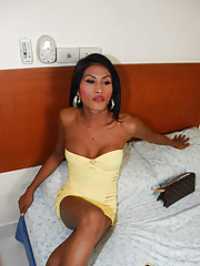 Dark skinned ladyboy in revealing dress