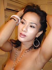 Petite ladyboy undressing for the camera