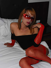 Ladyboy in red thigh high stockings