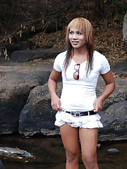 Pretty Ladyboy posing on outdoor place
