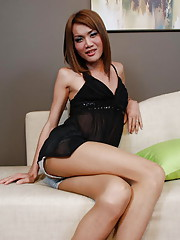 Redhead ladyboy in shorts and pantyhose strips