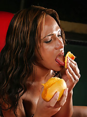 Horny brunette shemale shoves mango up her tight ass