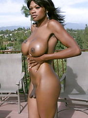 Big titted chocolate beauty Gina posing on the deck