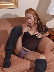 Gorgeous chocolate tgirl Sparkle posing on sofa