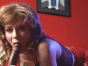 Jasmine Jewels in sexy latex costume giving a blowjob