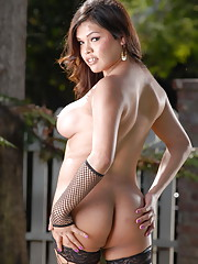 Naughty Carmen posing naked in sexy fishnet stockings