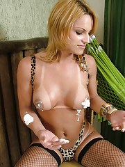 Horny blonde shemale uses whipped cream on her tits