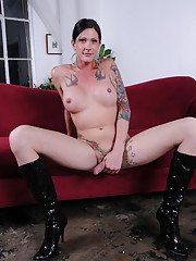 Gorgeous Morgan Bailey posing in long boots