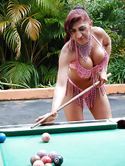 Sexy T-girl sticks pool ball in ass