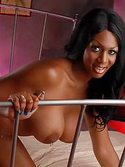 Black beauty Paris Pirelli stripping on the bed