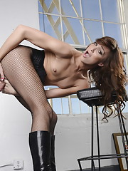 Seductive TS Jonelle teasing in black fishnet