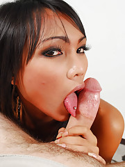 Sexy eyed femboy tongues juicy cock