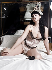Horny tgirl Bailey Jay stripping on the bed