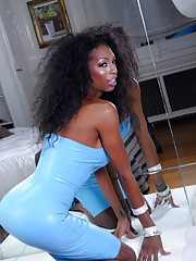 Chocolate tgirl Natassia stripping and posing